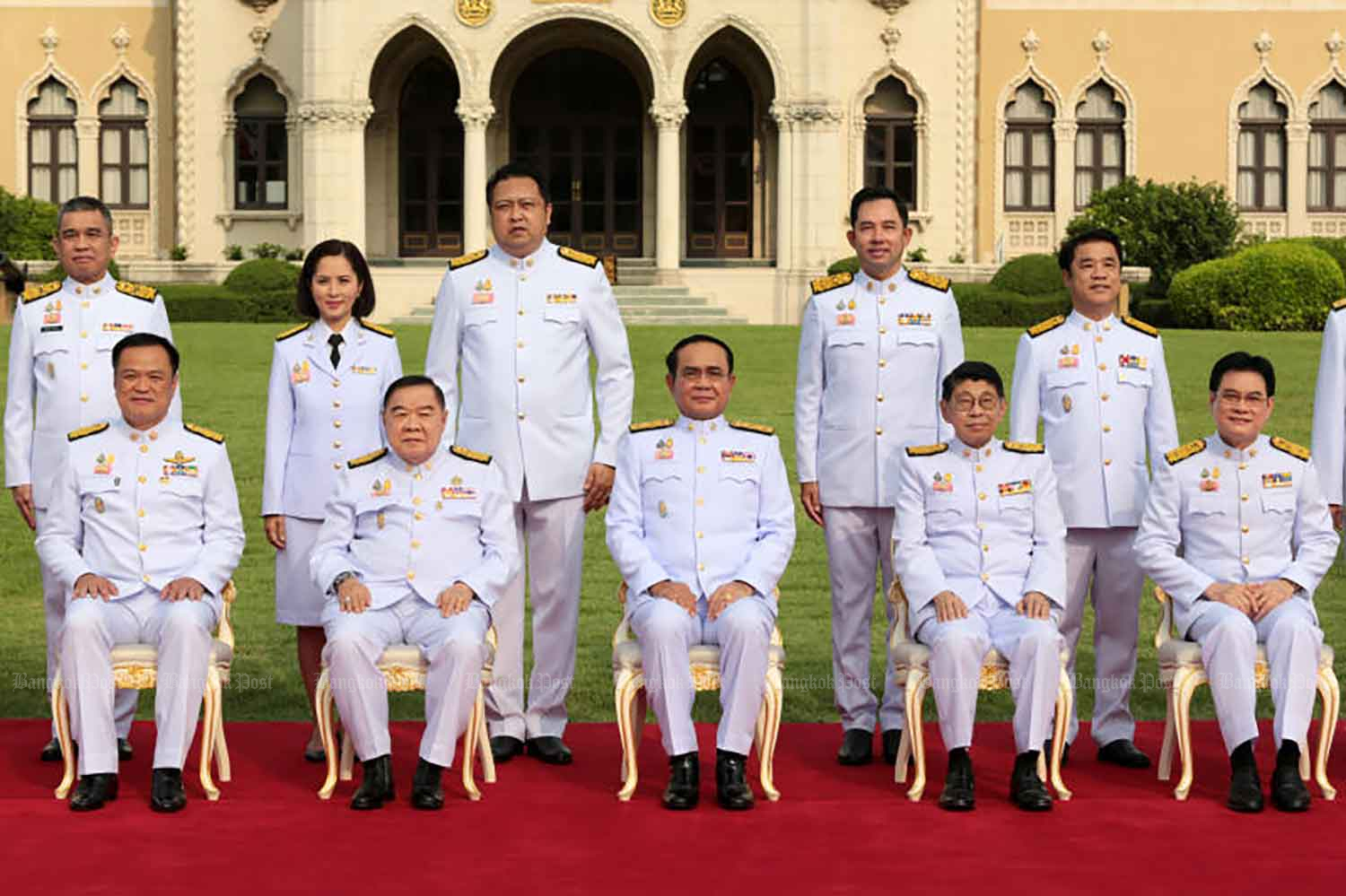 Prime Minister Prayut Chan-o-cha, seated centre, with new cabinet ministers at Government House in Bangkok on March 29. (Photo: Chanat Katanyu)