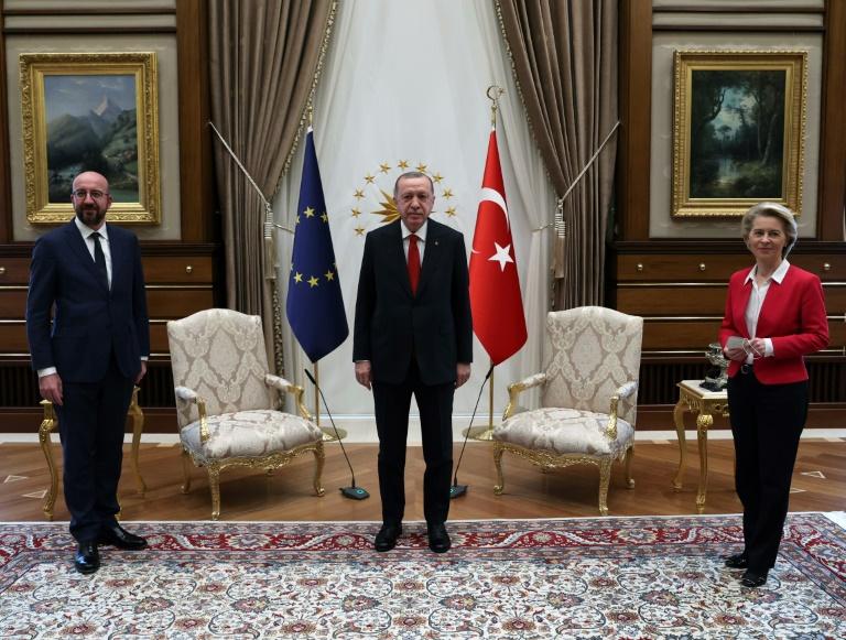 Three presidents, two chairs: Turkey's President Recep Tayyip Erdogan (centre) pictured with EU leaders Ursula von der Leyen and Charles Michel