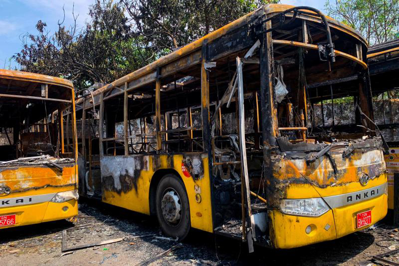 Buses from the Yangon Bus Service, which were burnt, are seen in Yangon on Monday, as the country remains in turmoil after the February military coup. (AFP photo)