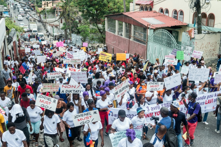 Haitians march in Port-au-Prince to commemorate the national day of the Haitian women's movement on April 3, 2021 -- the demonstrators denounced gang violence behind recent kidnappings and the government
