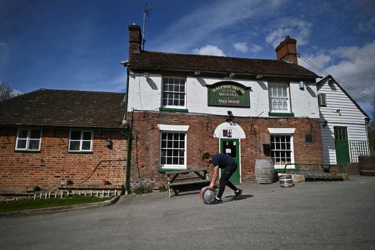 English pubs to reopen, India battles record surge: virus world update
