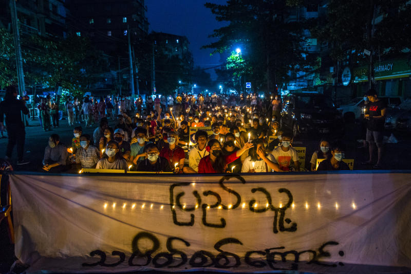 Anti-coup demonstrators, many with signs showing support for a civilian-formed federal army, hold candles and sing protest songs as they sit in the streets of Yangon, Myanmar, on April 3, 2021. (New York Times photos)