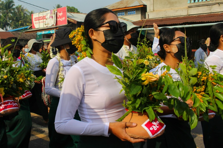 Protestors have been painting pro-democracy messages on flower pots traditionally displayed to welcome the Myanmar new year.