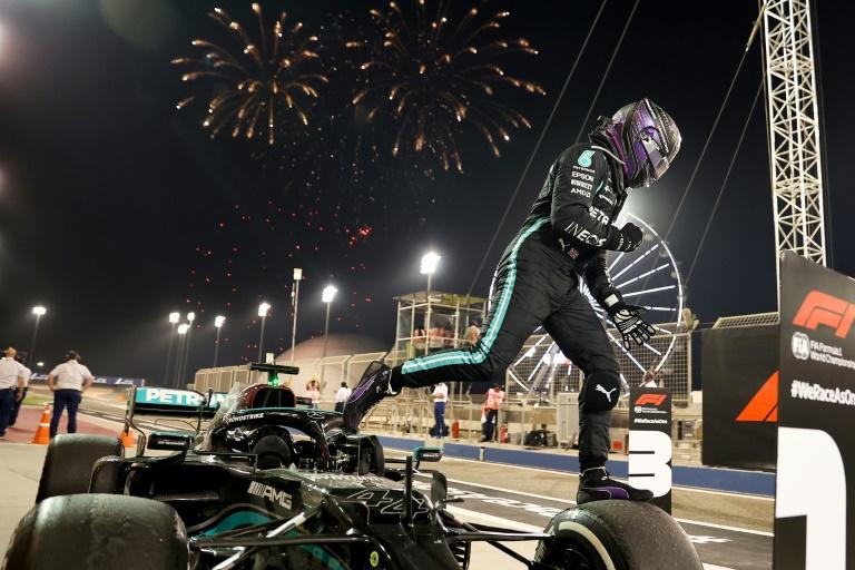 Winning start: Lewis Hamilton celebrates after victory in the season-opening Bahrain Grand Prix.