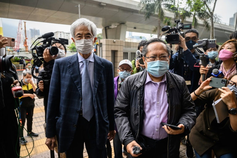 Former lawmakers Martin Lee (L) and Albert Ho arrive at West Kowloon court in Hong Kong to receive sentencing after being found guilty of organising an unauthorised assembly in 2019. (AFP photo)