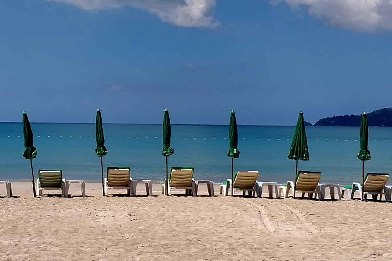 Beach chairs lie empty on the resort island of Phuket in January. (Photo by Achadthaya Chuenniran)