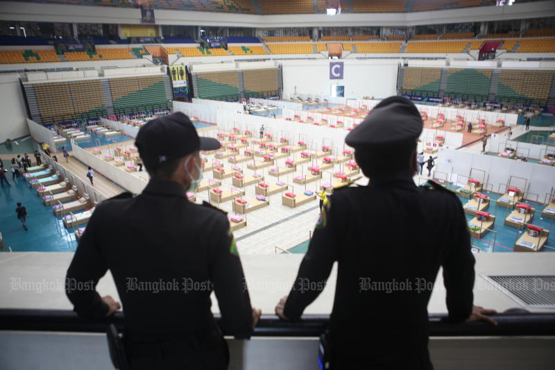 City Hall officials look at a new field hospital at Bangkok Arena in Nong Chok district on Sunday. (Photo by Apichart Jinakul)