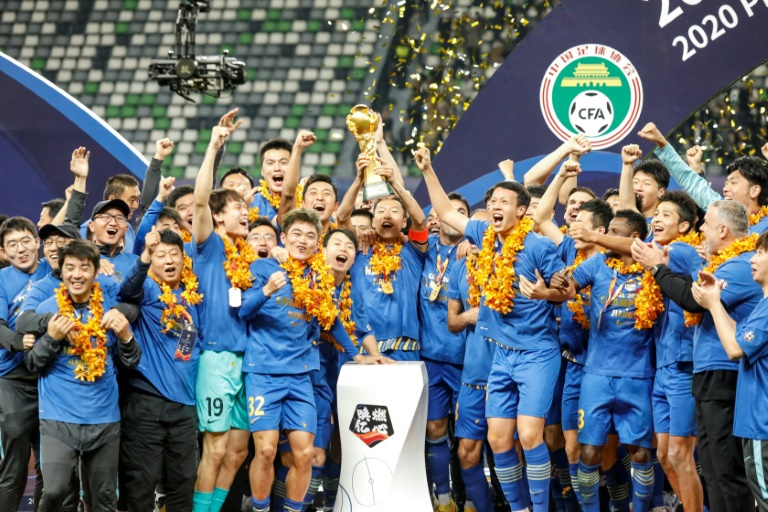 Jiangsu Suning celebrate winning the 2020 Chinese Super League after defeating Guangzhou Evergrande. China will attempt to move on from the collapse of the champions when the new season kicks off on Tuesday