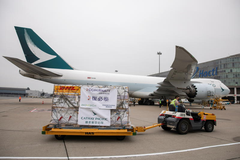 FILE PHOTO: Fosun-BioNTech Covid-19 vaccines are transported to a warehouse after being unloaded from a Cathay Pacific cargo plane at Hong Kong International Airport, in Hong Kong, Feb 27, 2021. (Reuters)