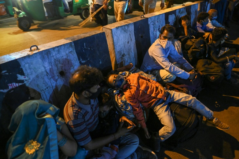 The looming virus lockdown of India's capital forced thousands to try and flee the restrictions.