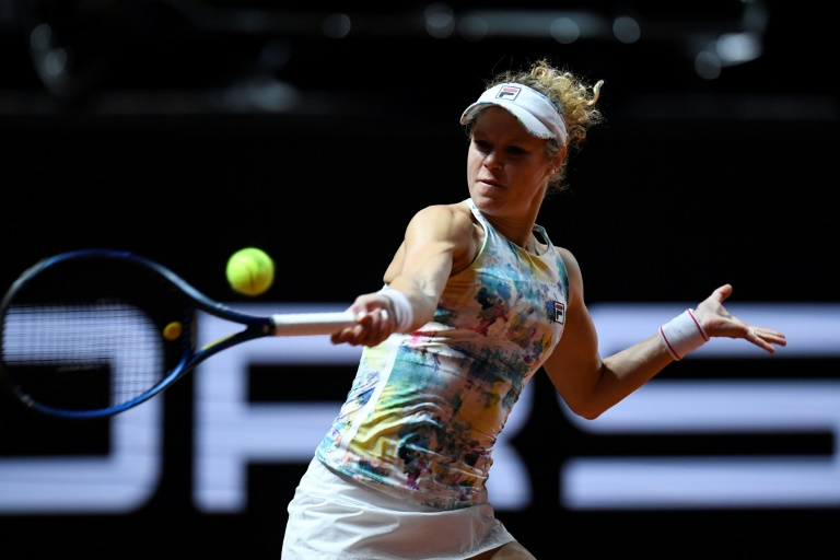 Germany's Laura Siegemund will meet top seed Ashleigh Barty in the second round of the WTA clay-court tournament in Stuttgart.