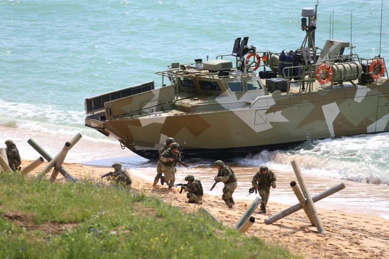 Russia begins drawdown of troops from Ukraine borders