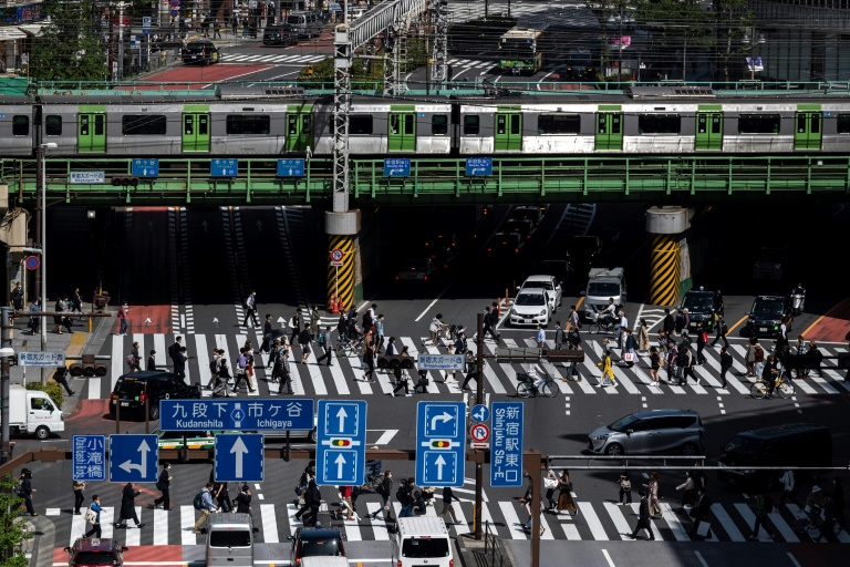 Japan declares virus emergency three months before Olympics