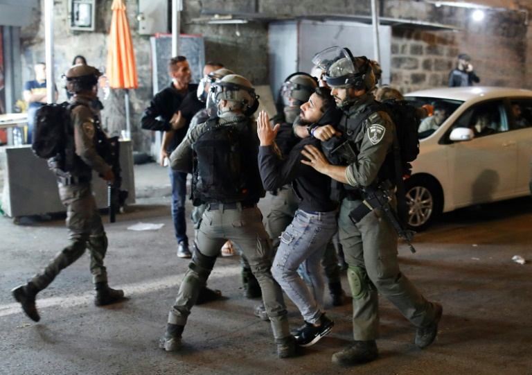 Israeli security forces detain a Palestinian protester outside the Damascus Gate in Jerusalem's Old City on April 23