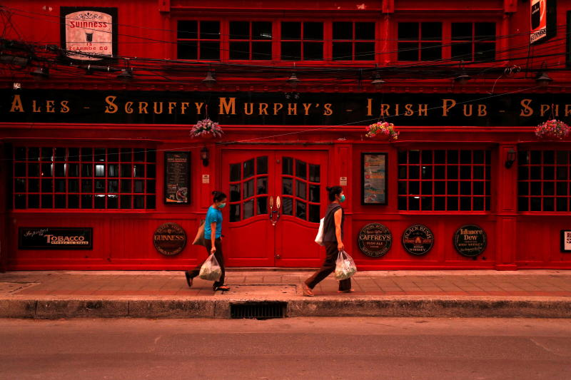 A closed bar is seen on Sukhumvit Road in Bangkok on Friday as the country struggles with a third wave of infections of the coronavirus. (Reuters photo)