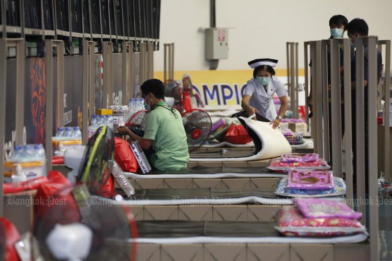 Officials prepare a new field hospital at Bangkok Arena in Nong Chok district, Bangkok, last Wednesday. (Photo: Varuth Hirunyatheb)