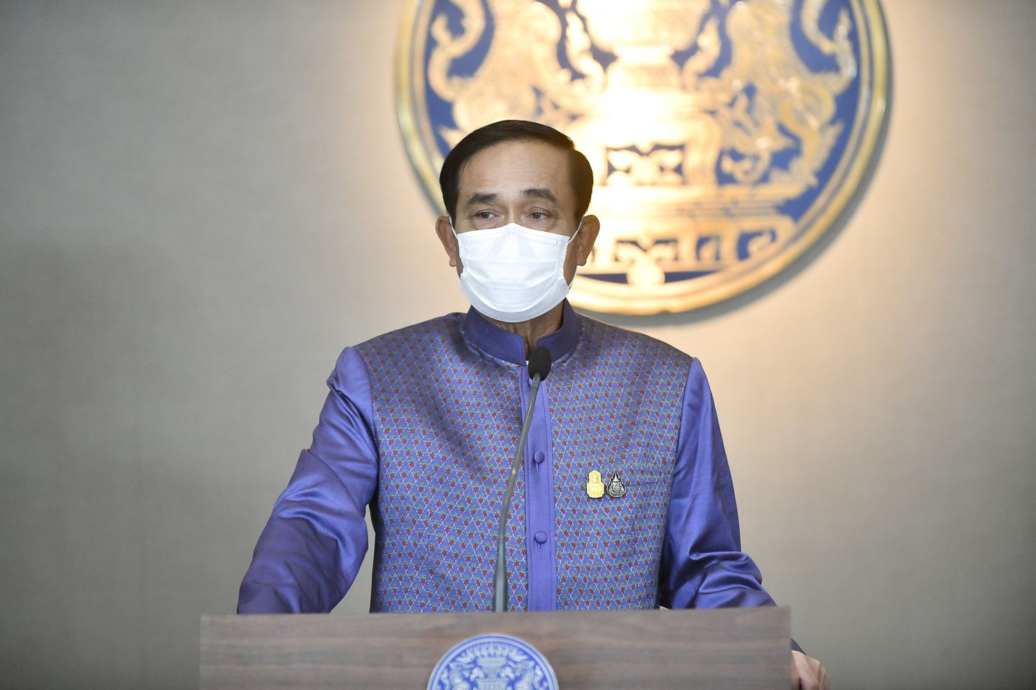 Prime Minister Prayut Chan-o-cha talks to reporters at Government House in Bangkok after a cabinet video conferencing on Tuesday. (Government House photo)