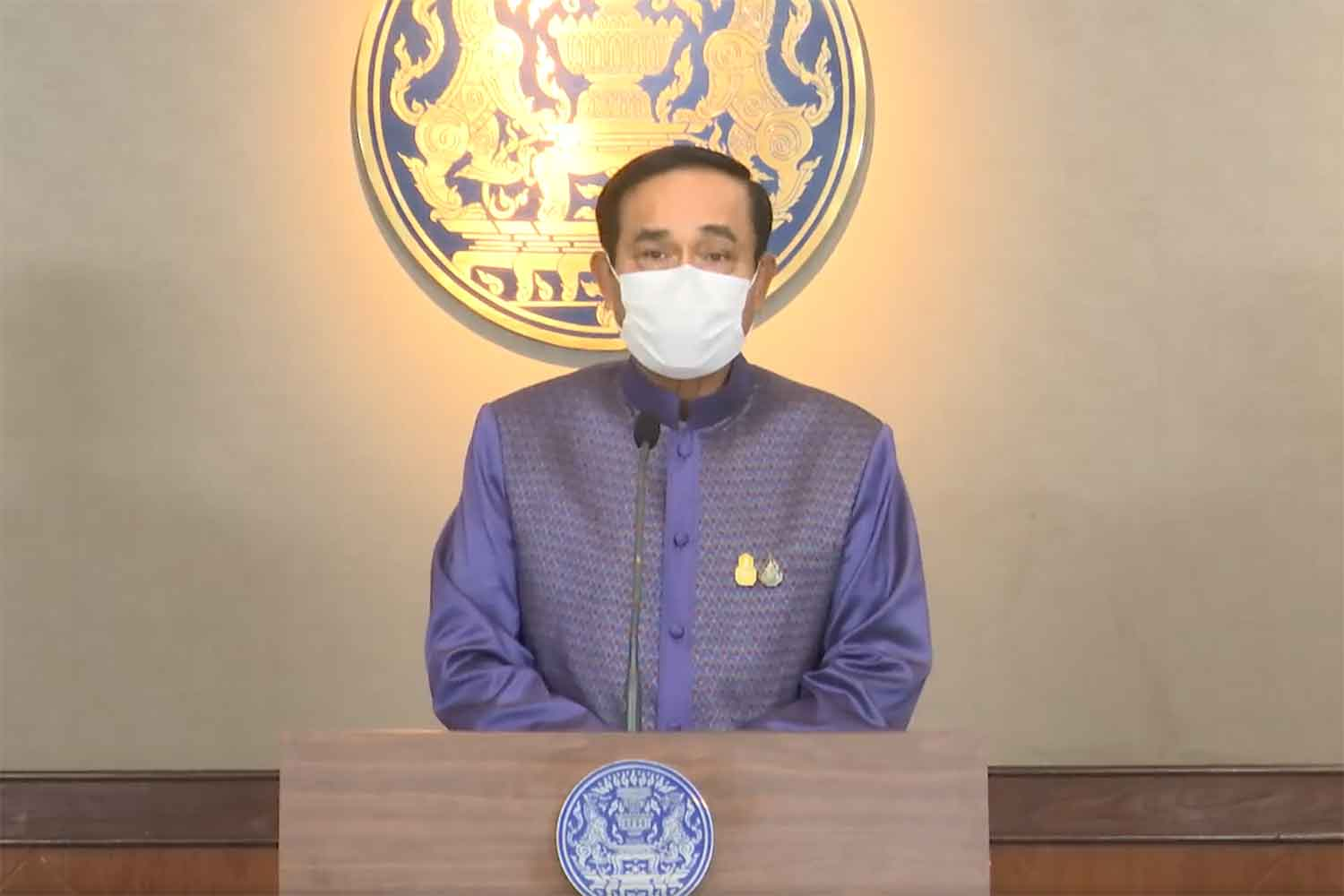 Prime Minister Prayut Chan-o-cha speaks to reporters at Government House in Bangkok on Tuesday. (Screenshot)