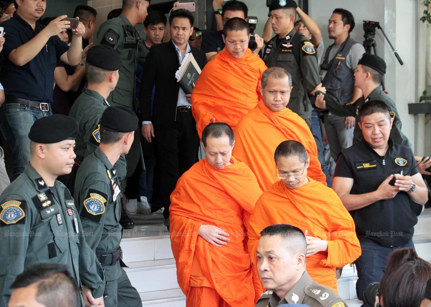 Senior monks from Wat Saket are summoned in 2018 to hear charges in connection with the temple fund embezzlement cases. Subsequently, five monks were disrobed and several given suspended jail terms.