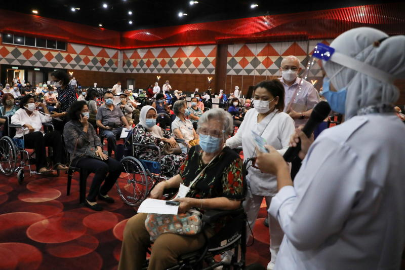 People wait to receive a vaccine for the coronavirus disease (Covid-19) at a vaccination centre in Subang Jaya, Malaysia on Monday. (Reuters photo)