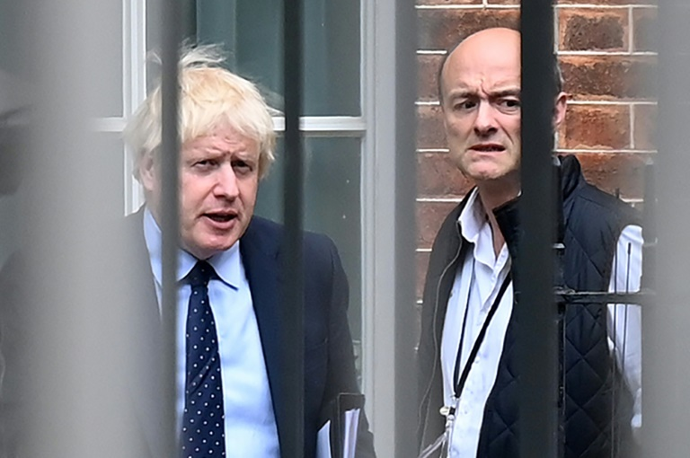 Johnson (L) has been locked in a war of words with his former top aide Dominic Cummings (R)