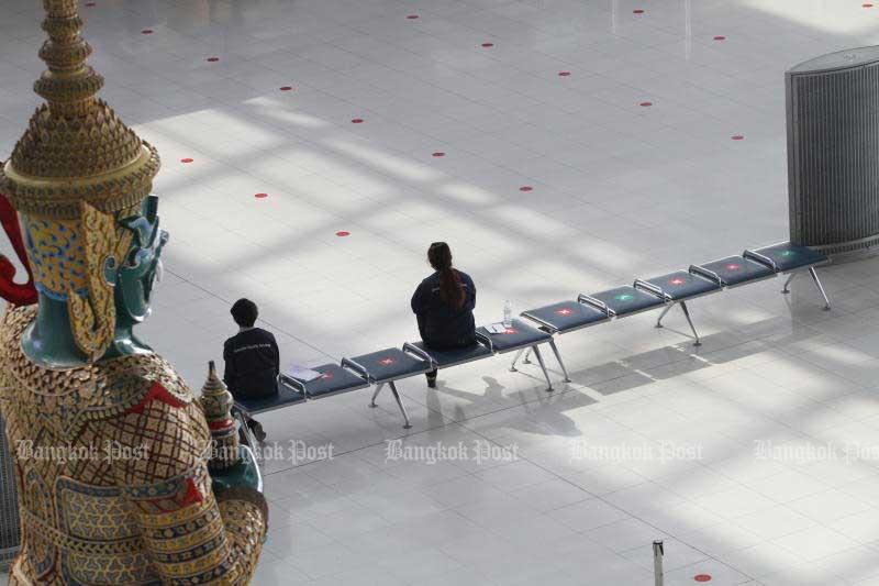 Officials sit at Suvarnabhumi airport. (Bangkok Post file photo)