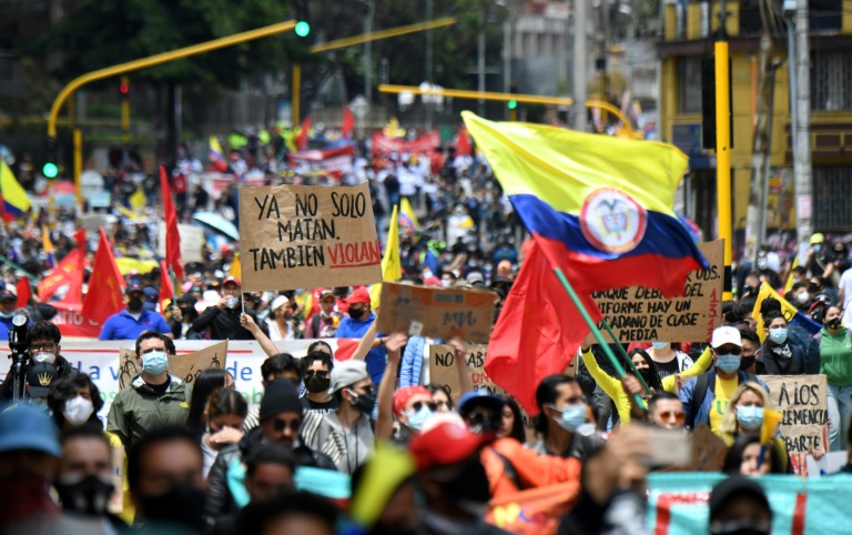 Colombians stage a protest march to denounce a tax reform plan in Bogota on May 1, 2021