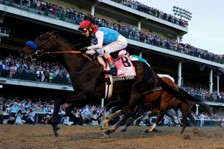 Medina Spirit, ridden by jockey John Velazquez, wins the 147th Kentucky Derby.