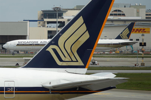 Singapore Airlines planes sit on the tarmac at Changi Airport. (Reuters photo)