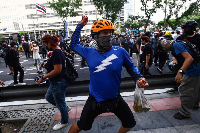 A protester prepares to throw a tomato as anti-government demonstrators call for the release of detained political activists, outside the Criminal Court on Sunday. (Photo: AFP)