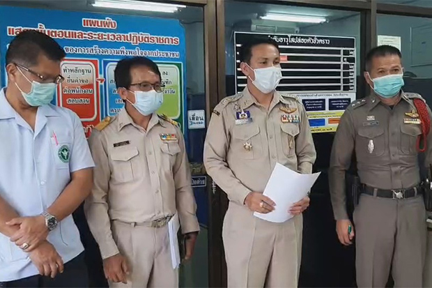 District and health officials prepare to register a complaint against a Ugandan man and his Thai wife at Soeng Sang police station in Nakhon Ratchasima's Soeng Sang district on Monday. (Photo: Prasit Tangprasert)