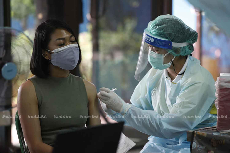 Covid-19 vaccination at Wat Klong Toey Nai in Klong Toey district, Bangkok, on Wednesday. (Photo: Varuth Hirunyatheb)