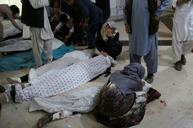 More than 30 dead, dozens hurt in blast near Afghan girls' school