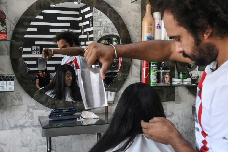 Pakistan barber offers hair-raising cuts, with blowtorch and cleaver