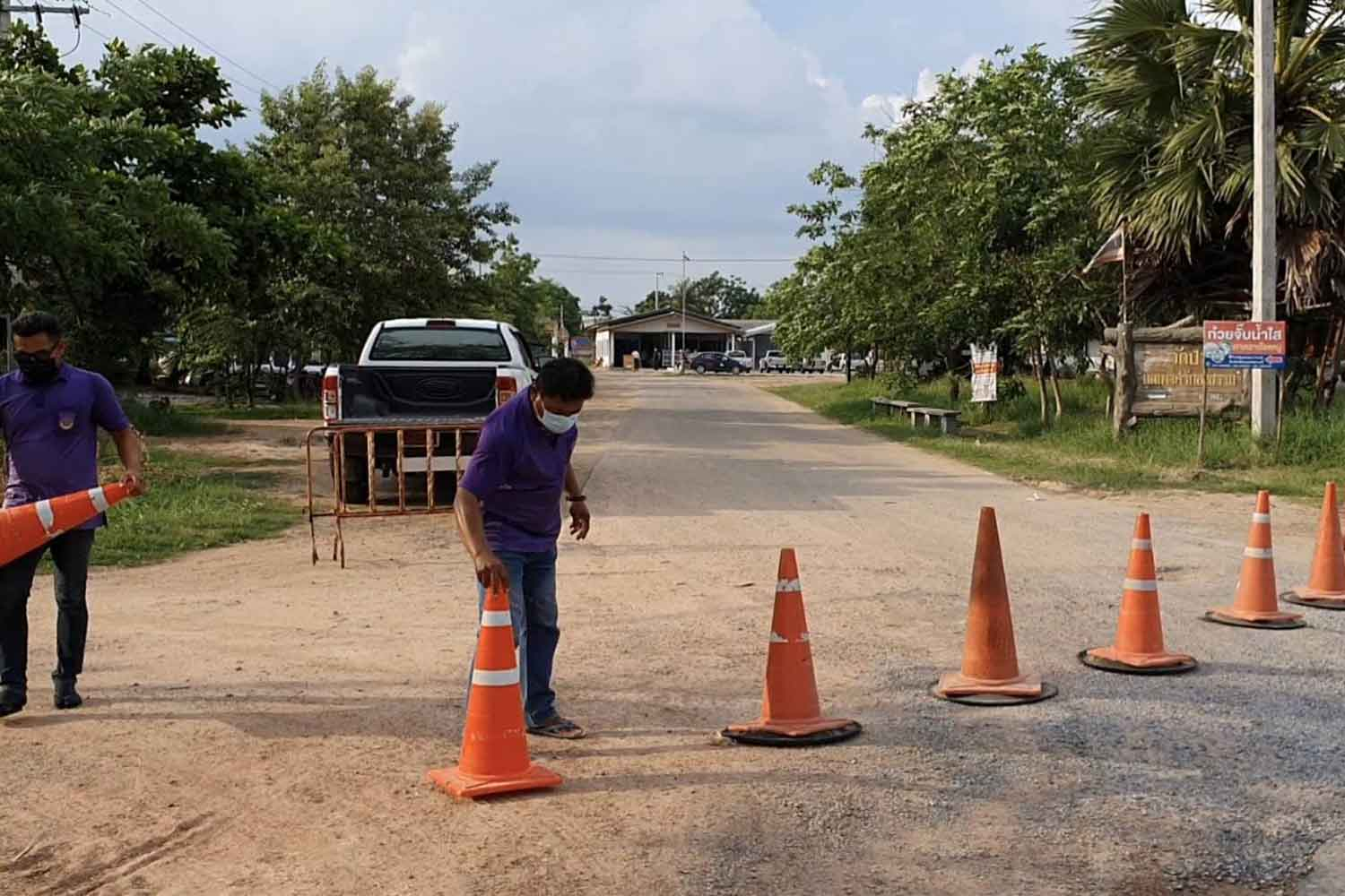 Traffic cones block the entrance to Ban Wang village in Nakhon Ratchasima's Non Thai district, which has been placed in lockdown after five people there were infected with Covid-19. (Photo: Prasit Tangprasert)