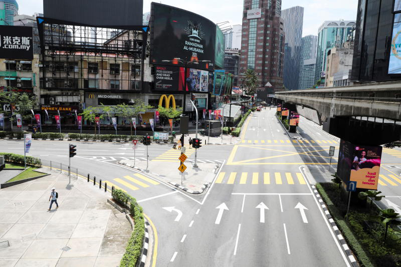 General view of a deserted street during a lockdown due to the coronavirus pandemic in Kuala Lumpur on Sunday. (Reuters photo)