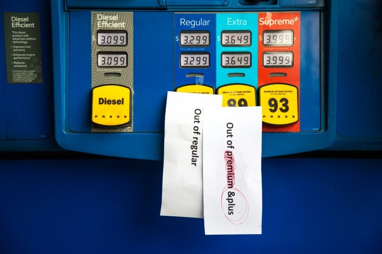 Notes are left on pumps to let motorists know they are empty at an Exxon gas station in Charlotte, North Carolina.