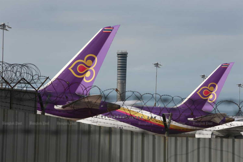 Thai Airways International planes are seen at Suvarnabhumi airport. (Bangkok Post file photo)
