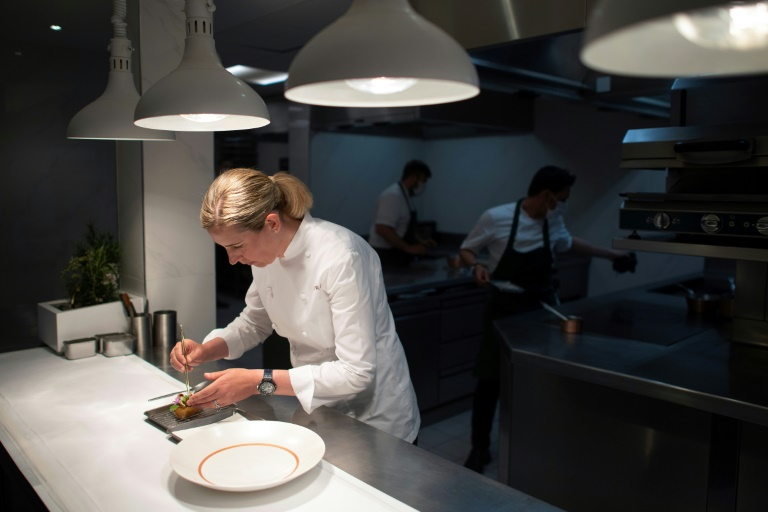 British chef Clare Smyth reopens doors after third Michelin star