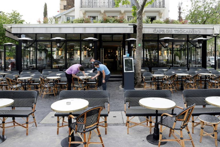 French hope bad weather won't rain off virus reopening