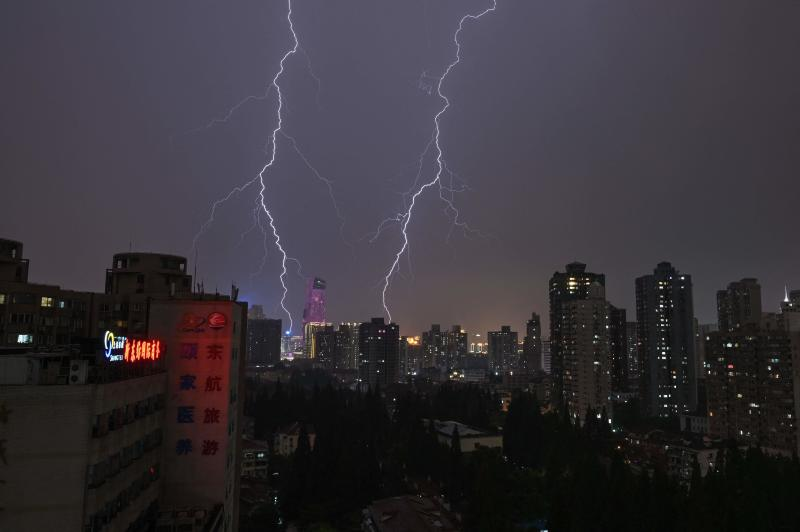 Lightning strikes during a thunderstorm over Shanghai on May 14, 2021. (AFP photo)