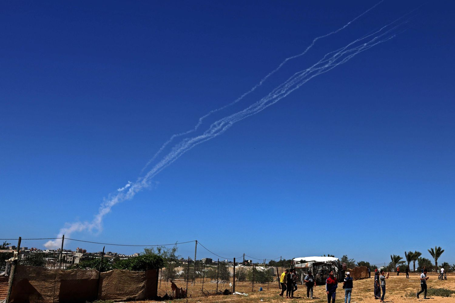 A picture taken on May 18, 2021 shows rockets being fired by Palestinian militants towards Israel near Rafah, in the southern Gaza Strip, on Tuesday. (AFP photo)