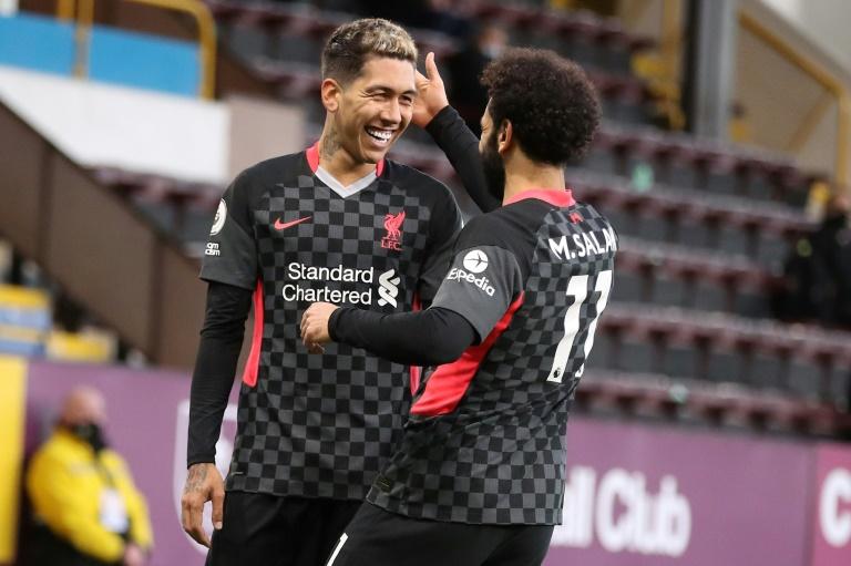 Liverpool's Roberto Firmino (left) celebrates scoring at Burnley