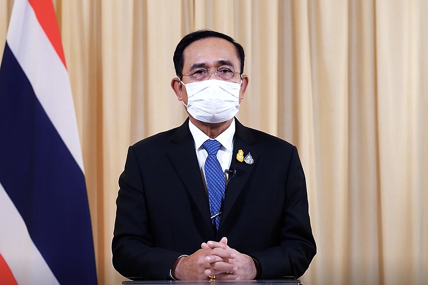 Prime Minister Prayut Chan-o-cha delivers a speech during the International Conference on the Future of Asia, an event organised by Nikkei, via a teleconference system at Government House.(Government House photo)