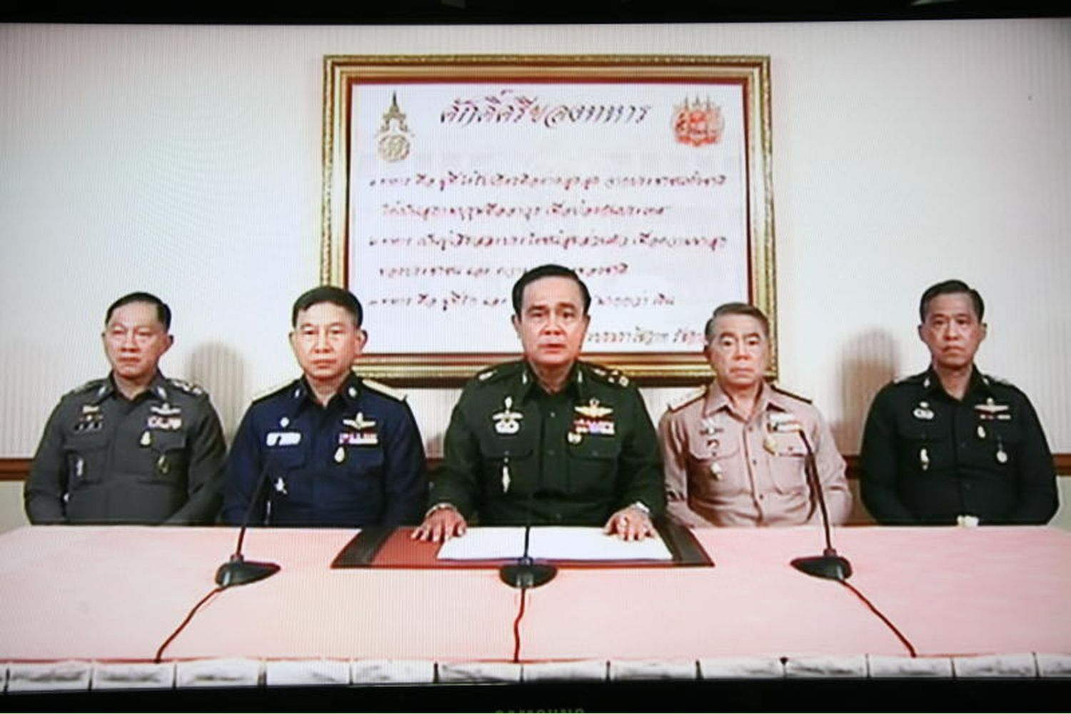 Commanders of the armed forces, led by Gen Prayut Chan-o-cha (centre), address the nation following the military coup on May 22, 2014.