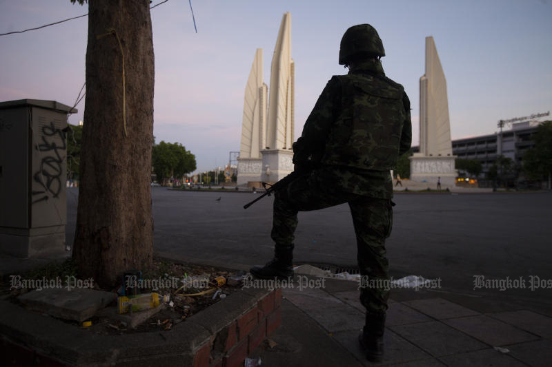 Soldiers stand guard blocking potential anti-coup protesters at Democracy Monument after the coup on May 22, 2014. (Photo by Patipat Janthong)
