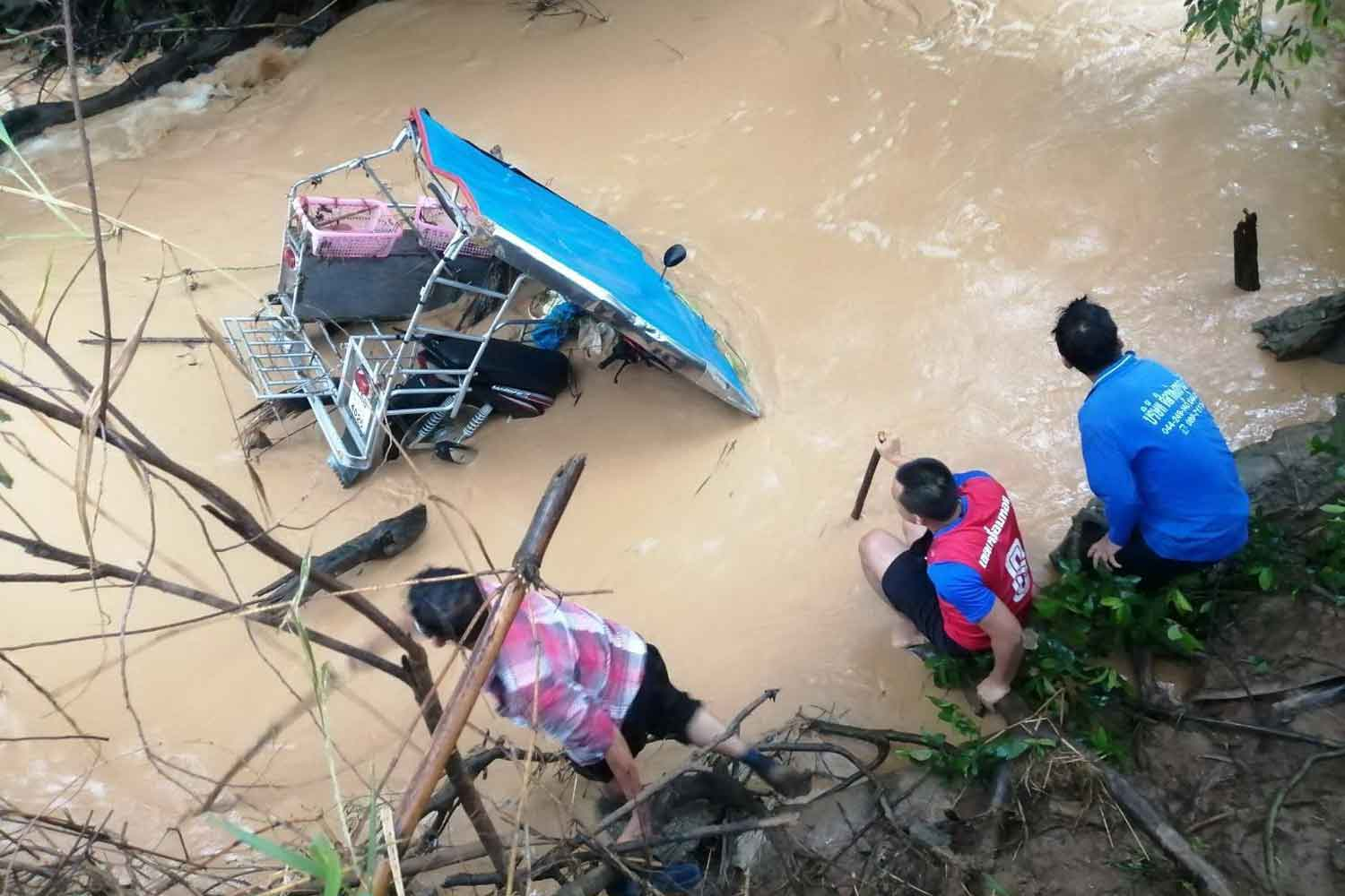 A motorcycle sidecar is found in a canal near a village in Nakhon Ratchasima's Wang Nam Khieo district. The motorcycle slipped into the canal early on Tuesday and the driver, a female villager, was swept away by a strong current and drowned. (Photo: Prasit Tangprasert)