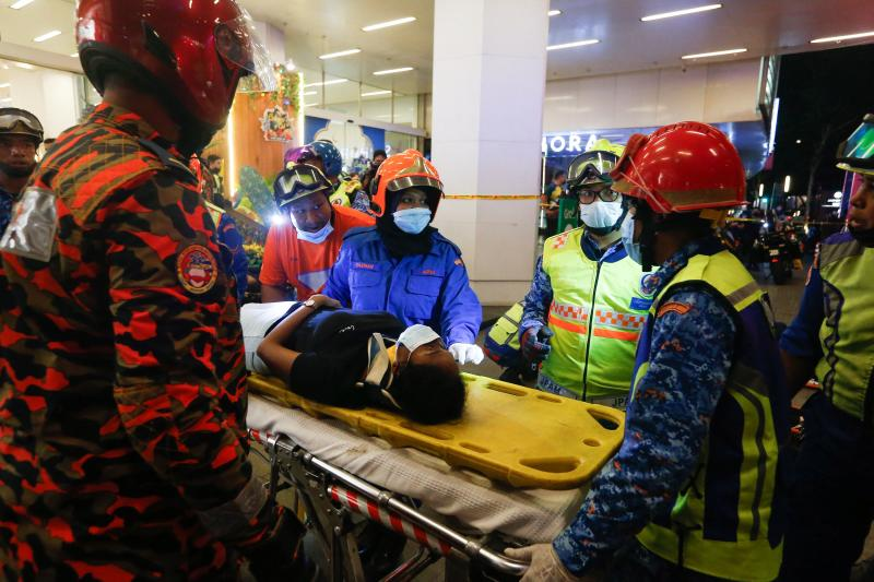 Rescue personnel tend to an injured passenger ooutside KLCC station after an accident involving two Light Rail Transit (LRT) trains in Kuala Lumpur. (AFP photo)
