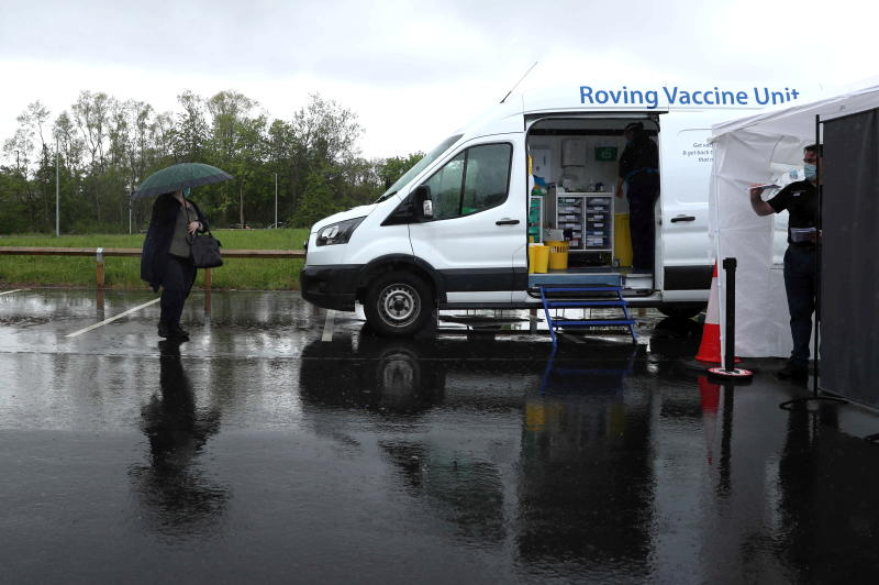 People visit a National Health Service mobile vaccination and testing unit at Northumberland Retail Park as cases of the Indian-origin coronavirus variant continue to rise in Shiremoor, North Tyneside, Britain on Tuesday. (Reuters photo)