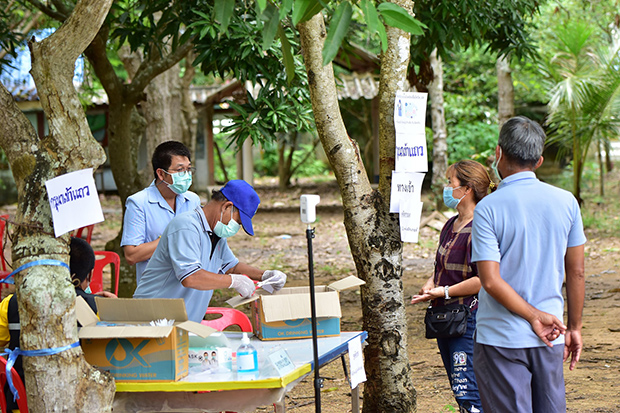 Health workers carry out Covid tests at an identified location in the northeastern province of Sa Kaeo on Tuesday. (Photo from Sa Kaeo public health office Facebook account)
